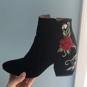 Black velvet block heel booties with floral design